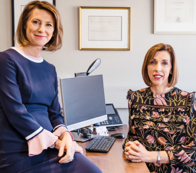 Dr Louise Newson and Dr Rebecca Lewis at a desk